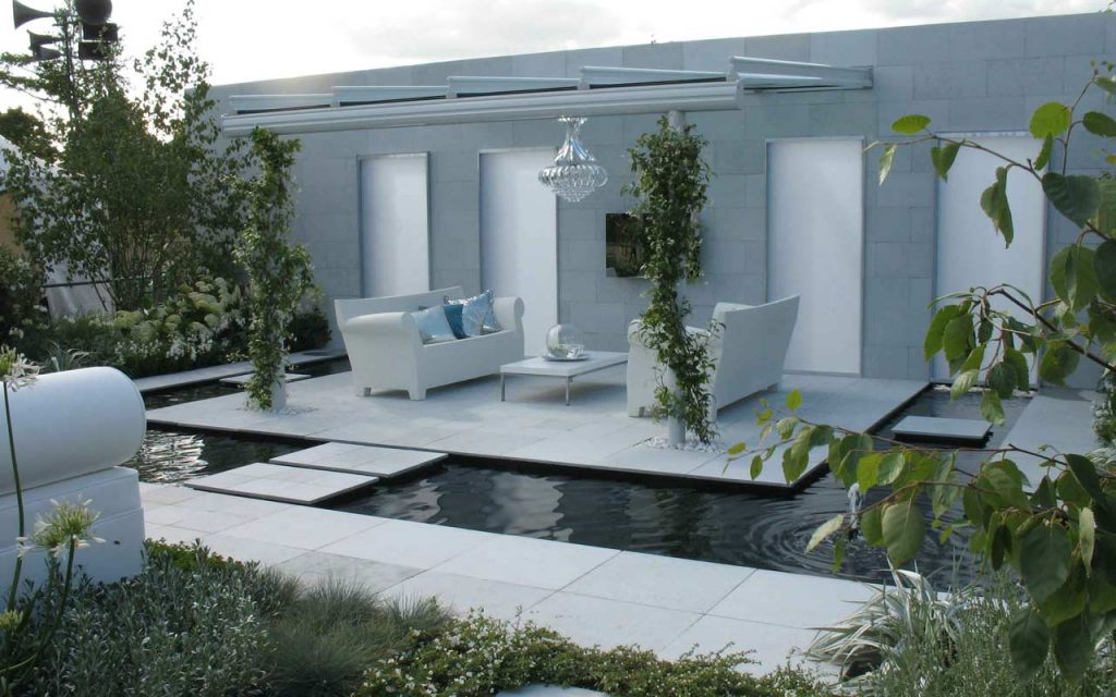 Award winning garden with sofa and water feature