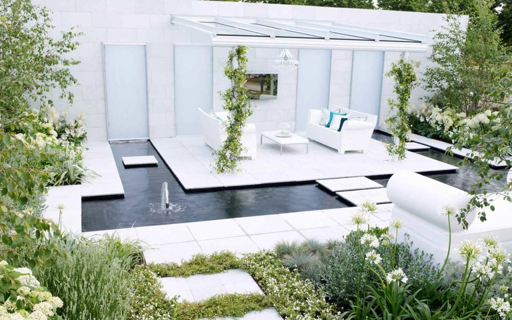 Award winning garden with sofas and water feature