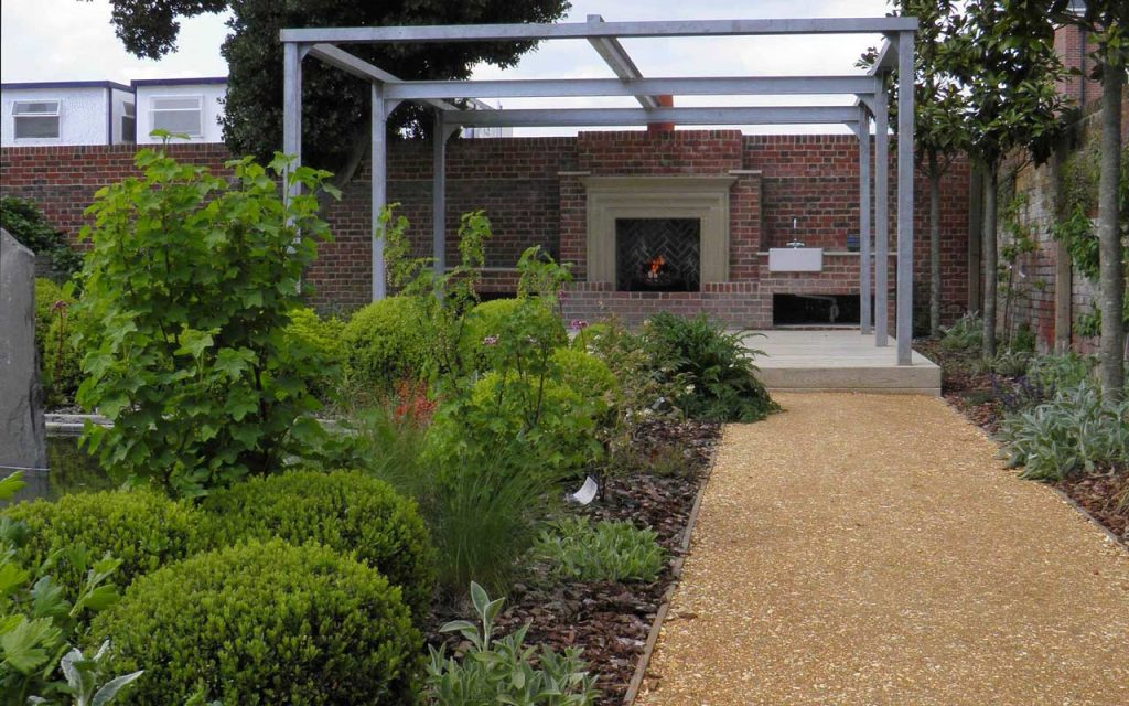 BALI Award garden with romsey gravel path and fireplace