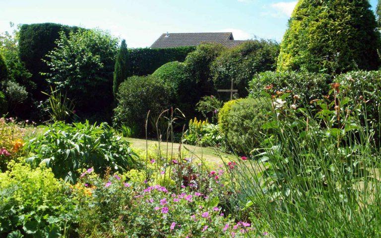 Beautiful garden beds in need of garden maintenance