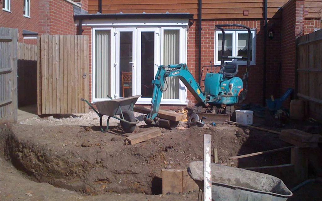 Image of digger constructing a garden