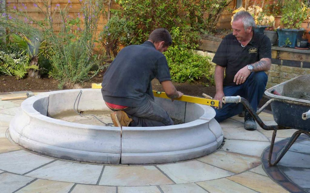 A team working on paving in a garden
