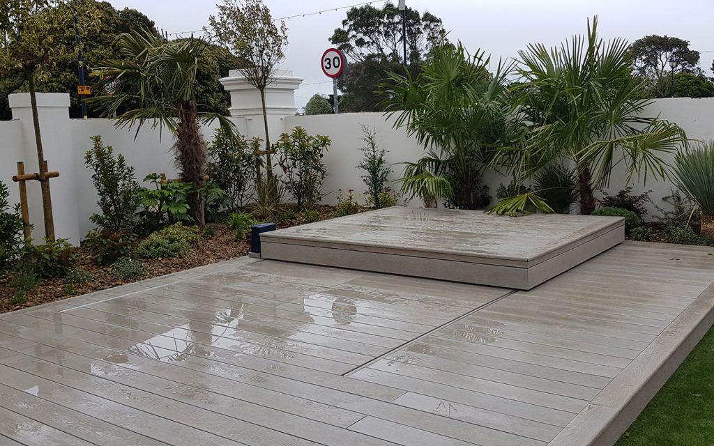 Modern garden with covered sunken hot tub