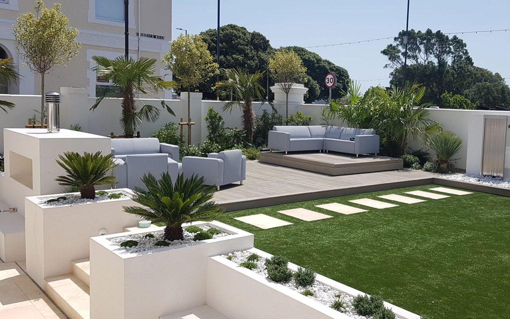 Modern garden with rendered beds and artificial lawn