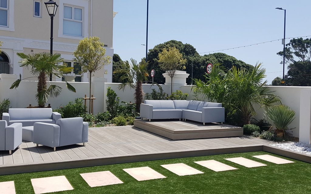 Modern garden with millboard decking and sofas
