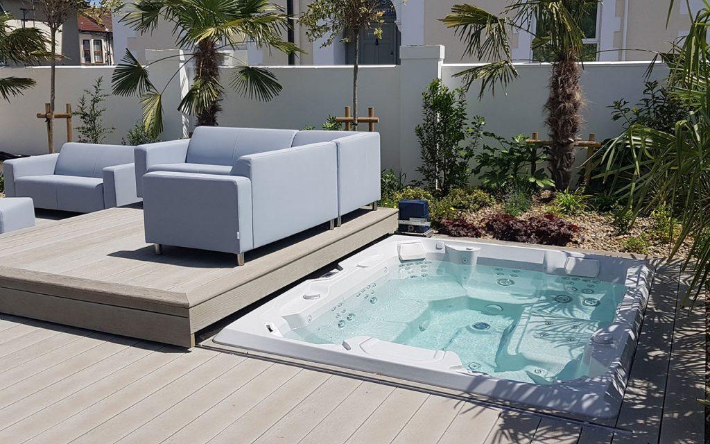Modern garden showing sunken hot tub