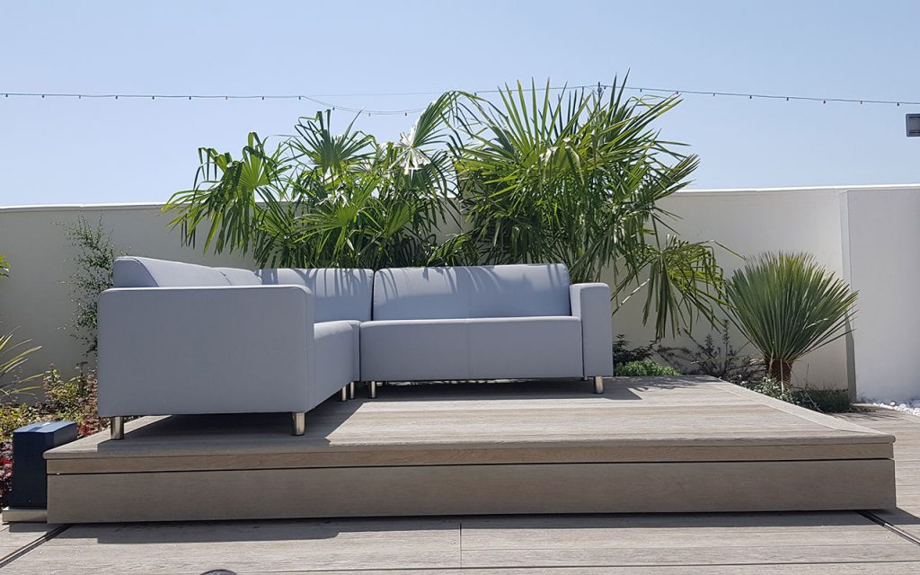 Modern garden with seating over covered hot tub